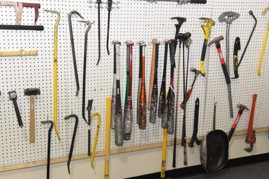 Choose your weapon.  If you don't feel like wielding of of these hammers, bats, hockey sticks or crowbars, there's also a row of sledgehammers to choose from at the Destruction Depot in Whitmore Lake.
