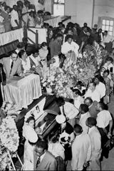 In this Sept. 3, 1955, file photo, mourners pass Emmett Till's casket in Chicago.