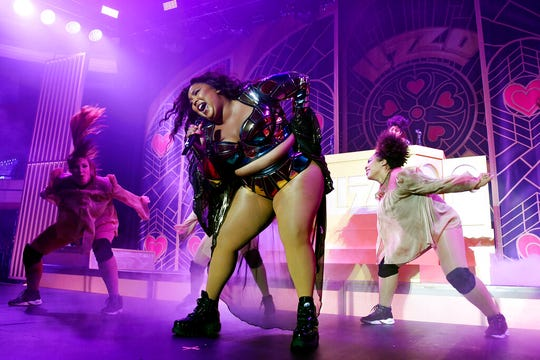 Musical artist Lizzo, center, performs with backup dancers at The Hollywood Palladium, Friday, Oct. 18, 2019, in Los Angeles.