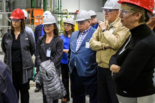 People listen to SABIC employees explain the process of making Acrylonitrile Butadiene Styrene, an impact-resistantengineering thermoplastic, which will be produced at the company's new Technology Center located in Mount Vernon, Ind., Wednesday morning, Oct. 23, 2019. The ABS produced in the facility will be used to make everything from household goods, mechanics, automotive and medical equipment.