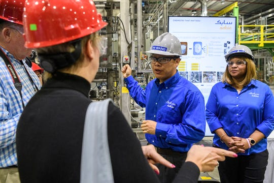 Shi Wang, center, and DaShawn Murray, right, answer questions about Acrylonitrile Butadiene Styrene, an impact-resistantengineering thermoplastic, which will be produced at SABIC's new Technology Center located in Mount Vernon, Ind., Wednesday morning, Oct. 23, 2019.