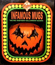 The evil pumpkin head is one of the Infamous Mugs Retro Inspired Halloween Masks offered by Malmey Masks.