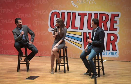 Donald Trump Jr., left, Kimberly Guilfoyle, center, and Charlie Kirk speak at a Turning Point USA event at Colorado State University in Fort Collins, Colo. on Tuesday, Oct. 22, 2019.