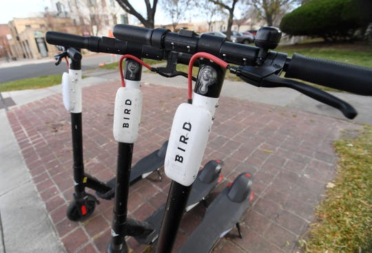 E-scooters are parked on a corner in Fort Collins, Colo. on Wednesday, Oct. 23, 2019.