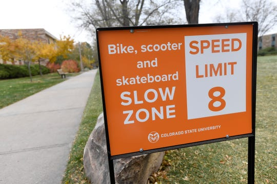 A sign informs riders to slow down to the speed limit on Colorado State University campus in Fort Collins, Colo. on Wednesday, Oct. 23, 2019.