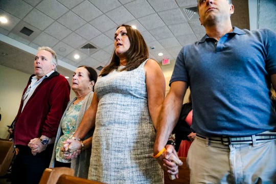 Teresa's brother Patrick Tottenham and her sister Ann  Lisa, hold hands with their mother, Mary Ann Groves as they wait for verdict to be read. Jimmy Rodgers was found guilty of second-degree murder, a lesser charge of first-degree murder in the death of Teresa Sievers.  He was also found not guilty of conspiracy to commit murder and he was found guilty of trespassing, a lesser charge of first-degree burglary while armed. Teresa's family held back their emotion as the verdict was read. Lee County Justice Center, Fort Myers, FL, October 23, 2019.