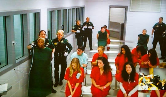 Michelle Ashley, left, also known as Michelle Jackson, makes her first appearance in court via video conference on Wednesday, Oct. 23, 2019, in Fort Myers. Ashley, 42, of Cape Coral, is charged with one count of first-degree murder for the June 19, 1997, slaying of Keith Jones, a Marine Corps veteran and police academy graduate, at the Tides Motel.