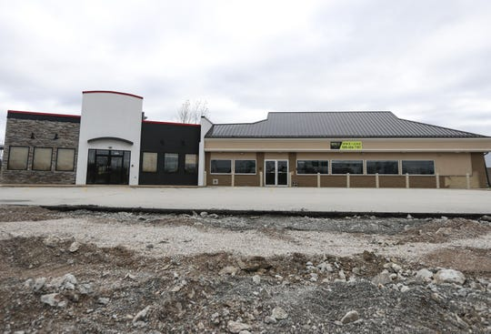 Vacant buildings sit side by side Wednesday, Oct. 23, 2019, at 1582 Lineville Rd. Suamico, Wis. Suamico-based Midwest Expansion plans to move Skaliwags by Chef Chris into one of the existing spaces. The group also plans to construct a new building that will house an Ahnapee Brewery taproom and several multi-unit apartment buildings to the north of the site. Ebony Cox/USA TODAY NETWORK-Wisconsin