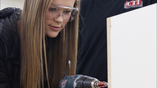 Luxemburg-Casco High School freshman Madelyn Loritz works with a power drill at CTI Hospitality, Inc. in Algoma during Kewaunee County Manufacturing Career Day on Oct. 15.