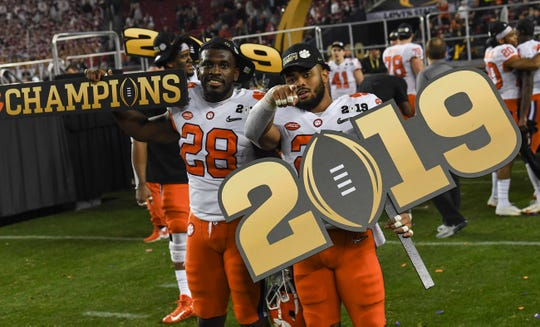 Clemson running back Tavien Feaster (28) and running back Darien Rencher (21) celebrate after the Tigers beat Alabama 44-16 to win the National Championship after the College Football Championship game at Levi's Stadium in Santa Clara, California Monday, January 7, 2019.