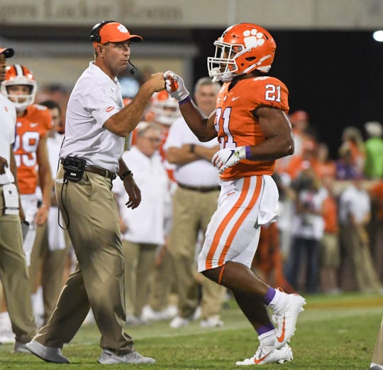 Clemson running back Darien Rencher (21) gets a fist bump from head coach Dabo Swinney after playing against Georgia Tech during the third quarter at Memorial Stadium in Clemson Thursday, August 29, 2019.