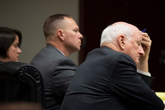 Will Lewis (center) and his wife Amy and attorney Rauch Wise sit in court on day three of Lewis' misconduct trial, Wednesday, Oct. 23, 2019.