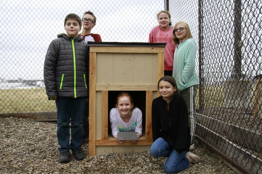 Student builders pictured with one of their dog houses (pictured: Issac evans, Killian Coy, Olivia Cordeiro, Skylar Ogg, RaeLeigh Carlson and Dakota Florchinger)