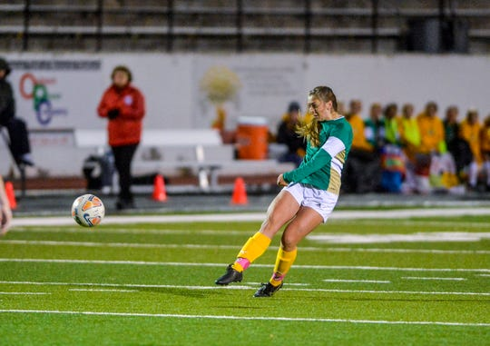 CMR's Haley Cochran takes shot on goal with a free kick during Tuesday's playoff soccer match against Great Falls High.