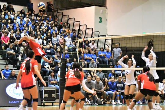 St. John's Tylee Shepherd goes sky-high to hit an outside set against Notre Dame during the IIAAG Girls Volleyball championship match Oct. 22 at the UOG Calvo Field House.
