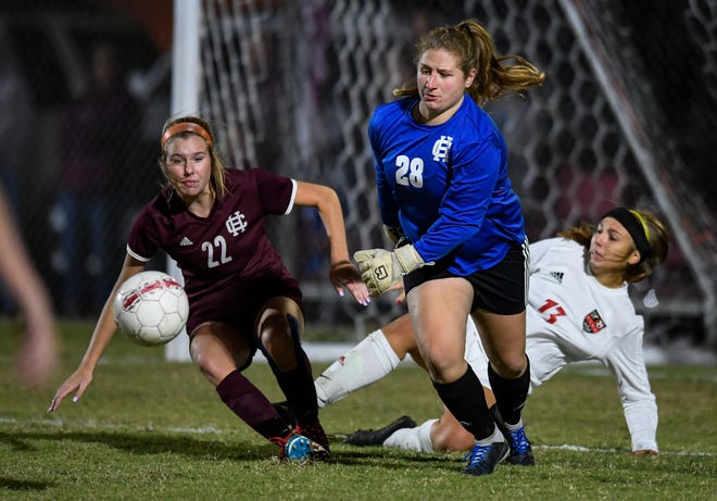 Henderson goalie Ashby Greenwell (28) and teammate Caitlyn Honeycutt (22) race to the ball as the Henderson County Lady Colonels play the Daviess County Lady Panthers in the first round of the state tournament at Henderson's Colonel Field Tuesday evening, October 22, 2019.