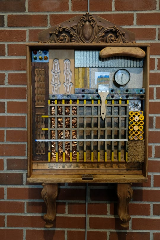 """""""A House Divided"""" by Michael Pittman won the Henderson Breakfast Lions Award in the Art of Recycling VIII exhibit."""