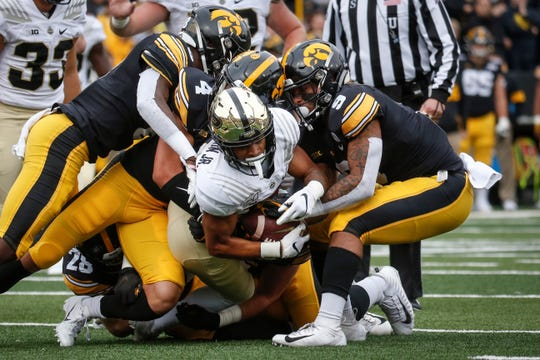 Iowa's defense, here causing a fumble against Purdue, have been especially aggressive in practice in the past 2-3 weeks.