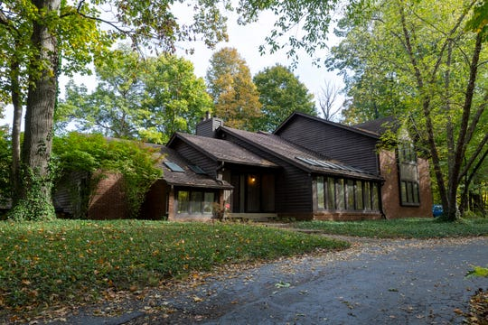 This home on the northwestside is situated on a heavily wooded lot near Trader's Point.
