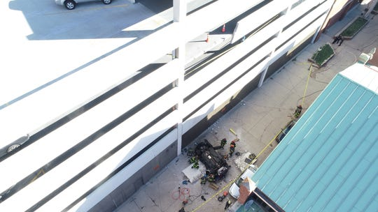 2 people were killed after a vehicle fell from a downtown parking garage in Indianapolis