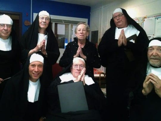 Musical comedy was a hallmark of June Braverman's Iowa City performances.  Here, the director prayerfully poses with local men she coerced into portraying singing and dancing nuns.
