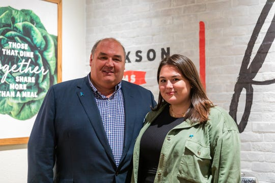 Chris Newcomb, CEO of Newk's Eatery, and daughter Madison Newcomb celebrate renovations of the Jackson area locations of Newk's.