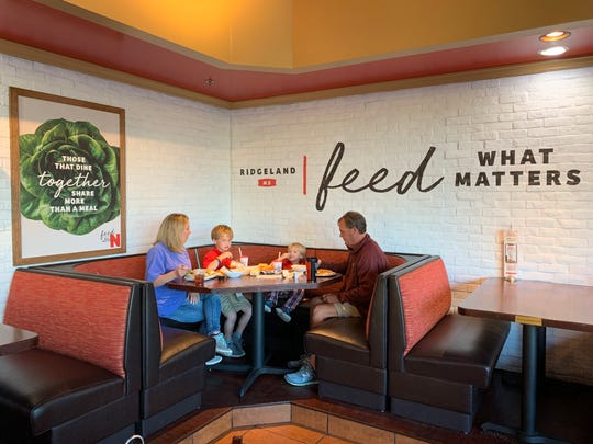 Stacey Williams of Madison, left, dines with sons, Nash Williams and Knox Wiliams, and her husband, Thad Williams, at Newk's Eatery on Lake Harbour Drive in Ridgeland, which recently had its dining room updated for a new look.