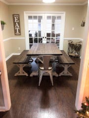 The first dining table and bench that Meagan Kahn hand built before she launched Izzy's Attic 3½ years ago.