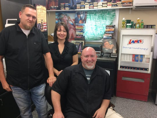 Doug McNelly (in chair), is flanked by co-workers Tyler Frost and Amanda McManus.