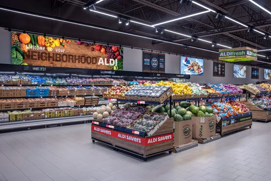 The new Aldi store layouts feature open ceilings, natural light and eco-conscious building materials.