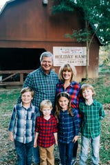 Rocky and Betsy Ramsey with their four grandchildren.