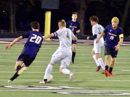 Bloom-Carroll's Aidan Kovacs and Johnstown's Josh Cook fight for the ball during a Central District Division II district semifinal Tuesday at Bloom-Carroll. The Bulldogs won, 2-1.