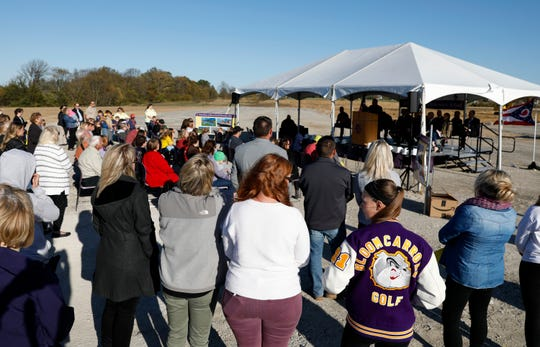 A crowd of people look on during the groundbreaking ceremony for the new Bloom-Carroll Elementary Thursday, Oct. 23, 2019, in Greenfield Township.