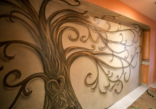 A tree mural in the entryway of Robyn Zapp's condo in Riverpointe Plaza in Jeffersonville.