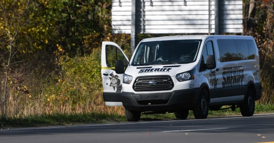 Police on US 127 south near Mt. Hope Avenue after an Ingham County Jail inmate jumped from a van that was transporting prisoners on Wednesday, Oct. 23, 2019.