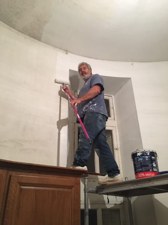 Kurt Stimens is painting the kitchen in his new castle. The ceiling is 15-foot high.
