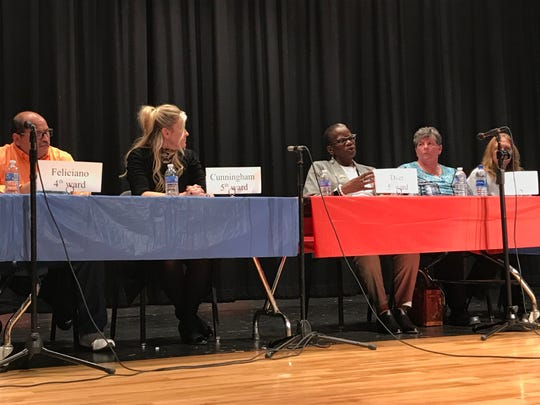 Marion City Council candidates, including Tara Dyer, center right, a Democrat running for 5th ward, and Leslie Cunningham, center left, the Republican incumbent in the council's 5th ward, discuss their views at the League of Women Voters of Marion County's candidates' debate Tuesday.