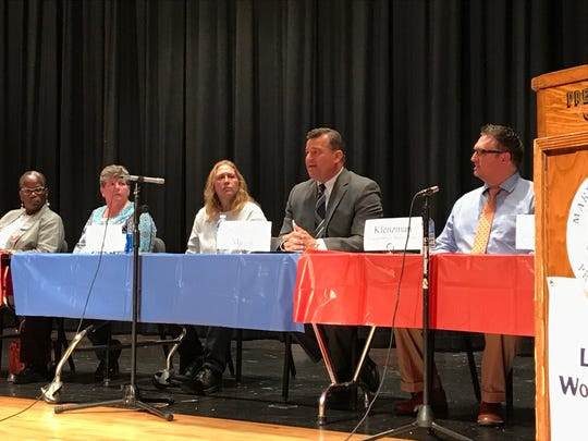 Marion Mayor Scott Schertzer talks about his plans for the city at the League of Women Voters of Marion's candidates' debate Tuesday. Schertzer is running for a fourth term as mayor against Sue McGowan, center left, who is running as an independent, and Kevin Norris, a Republican who was not at the debate.