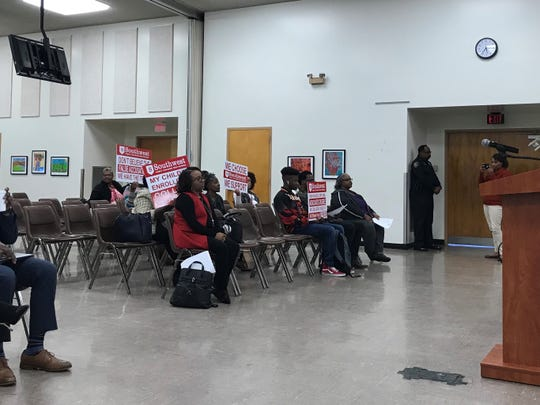 Parents and students supporting Southwest Early College High attend the Oct. 22 meeting with signs of support branded by the high school. The board vote determining the status of the charter will occur Oct. 29 after a grievance meeting Oct. 28.