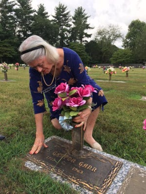 """Devereaux """"Devy"""" Bruch Eyler, 81, visits the grave of her biological father after discovering she was stolen and sold to another family as a baby by Georgia Tann."""
