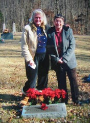 "Devereaux ""Devy"" Bruch Eyler, 81, was among many babies stolen and sold to new families as part of the Georgia Tann adoption scandal. She and biological sister Pat Wilks stand at their mother's grave."