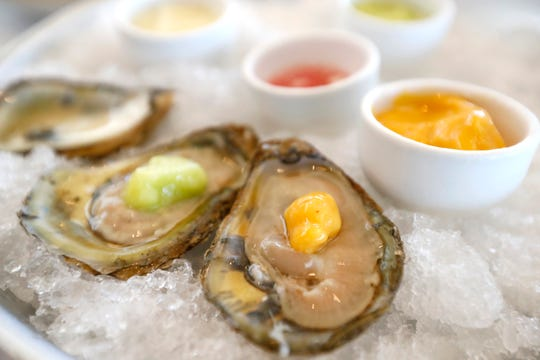 Delaware Bay Blue Point Oysters with passion fruit chili and apple wasabi sorbet at Coastal Fish Company at Shelby Farms Park on Tuesday, Oct. 22, 2019.