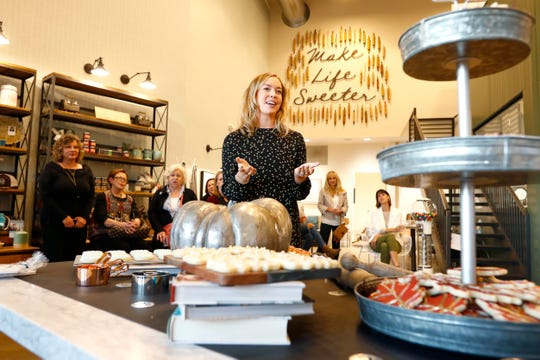Lifestyle blogger Cara Greenstein talks to women gathered for a lesson on how to host a holiday cookie swap at Sweet LaLa's Bakery on Tuesday, Oct. 22, 2019.
