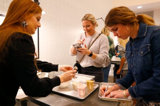 Grace Griffin, from left, Elizabeth Loony Scott and Stephanie Stephens create their own desserts in a workshop by Lifestyle blogger Cara Greenstein, who teamed up with Sweet LaLa's Bakery to teach a class on how to host a holiday cookie swap Tuesday, Oct. 22, 2019.