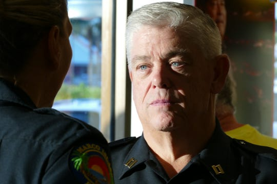 Captain Richard Stoltenborg of the Marco Island Police Department (MIPD) speaks with chief Tracy L. Frazzano at a Coffee with a Cop event in a Subway on Oct. 23, 2019. Stoltenborg has been serving since 1981.