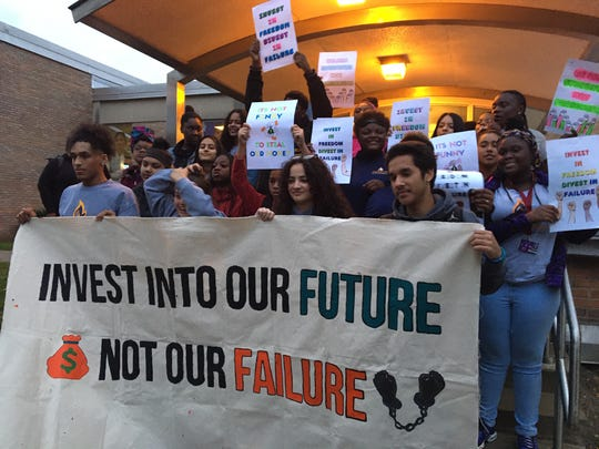 Members of the student advocacy group Leaders Igniting Transformation gather for a news conference outside Milwaukee Public Schools central offices on Tuesday, Oct. 22, 2019. The students turned out to testify against a plan to upgrade airport-style X-ray scanners at several schools.