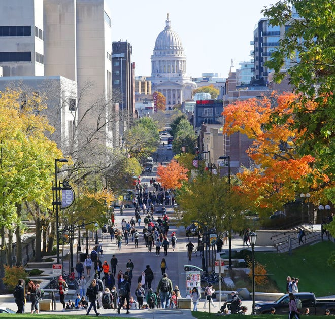 Students walk to classes on campus along State Street with the Madison state capitol in the background at the University of Wisconsin Madison on Wednesday, Oct. 23, 2019. - for file if needed - College, tuition, regents, UW system, education   Photo by Mike De Sisti/Milwaukee Journal Sentinel