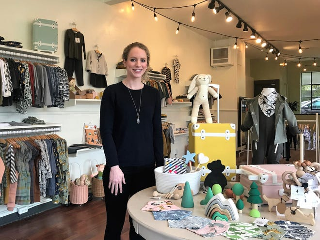 Emma Carollo, owner of BlackBear Children's Boutique, is pictured in her new Shorewood store at 4312 N. Oakland Ave.