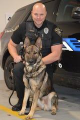 Muskego Police Officer Gregory Slamka is police K-9 Obi's handler.