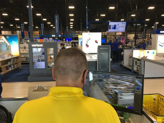 Best Buy employees set up Wednesday during a soft opening at the new 7701 Eastchase Parkway store.